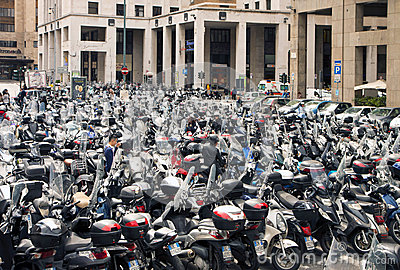 Open air scooter and motorbike parking in Genoa, Italy Editorial Photo
