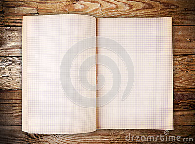 Open blank note book on old wood