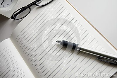 Open blank notebook with pen