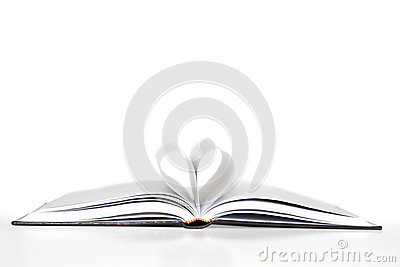 Open book, pages making heart