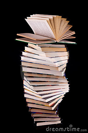 Open book on stack of books