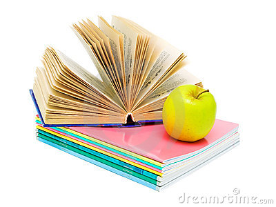 Open book, a stack of notebooks and an apple