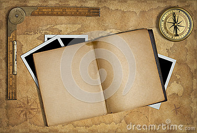 Open diary over old treasure map and compass