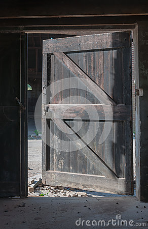 Open door in a neglected barn