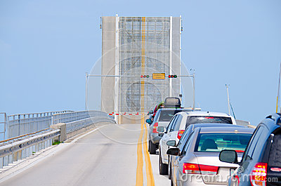 Open drawbridge with cars waiting to cross bridge