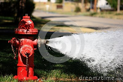 Open Fire Hydrant Spraying High Pressure Water