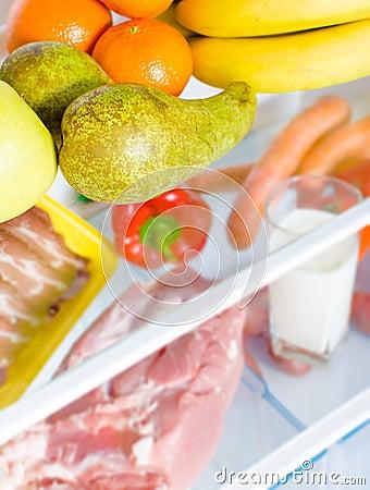 Open fridge full of fruits