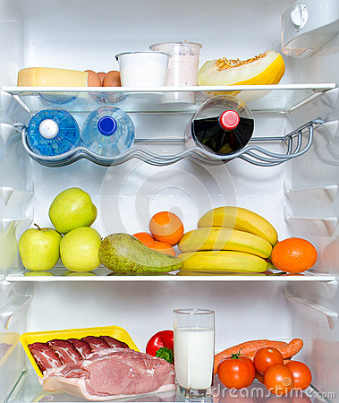 Open fridge full of fruits