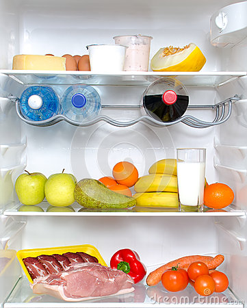 Open fridge full of fruits and meat