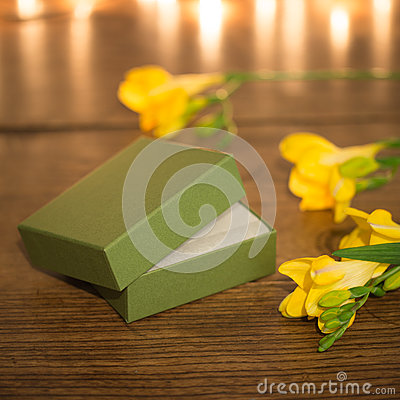 Open gift box with flowers and evening lighting