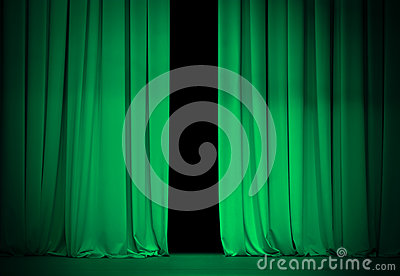 Open green or emerald curtains on theater stage