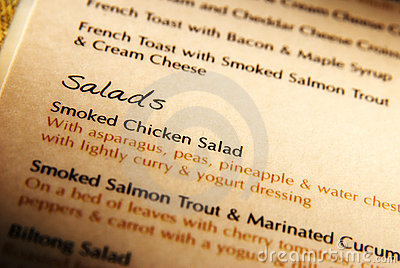 Open menu book with salads