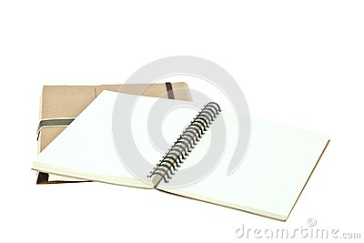 Open note book on brown book