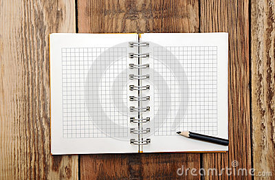 A open note book with pencil
