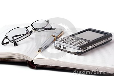 Open notebook with smartphone
