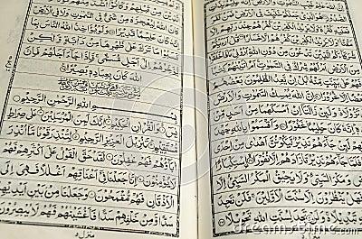 Closeup of an open quran with text of surah yaseen