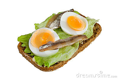 Open sandwich with egg, salad and anchovy