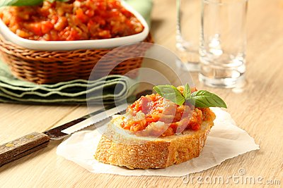 Open sandwiches with eggplant salad (caviar) and basil leaves