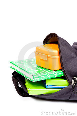 Open schoolbag with books and lunchbox