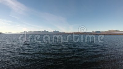 Open sea landscape with waves and mountain islands. Background stock video footage