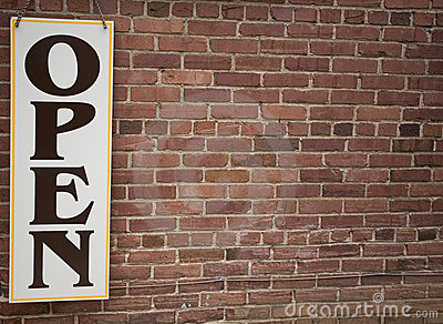 Open Sign and Brick Wall