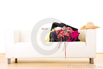 Open suitcase on settee