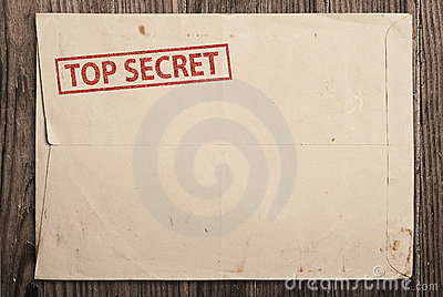 Open top secret envelope on table.