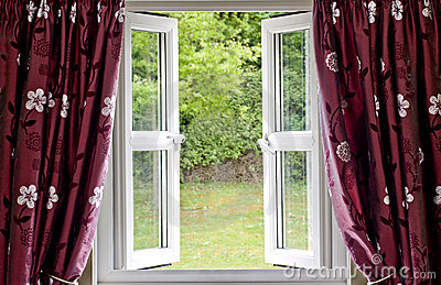 Open window draped in curtains
