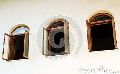 Open windows on white wall