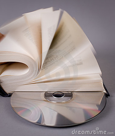 Free Opened Book With Compact Disk On Grey Stock Photos - 13311593