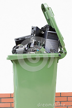 Opened garbage bin with electronics