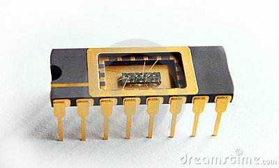 Opened IC with chip inside on the white background