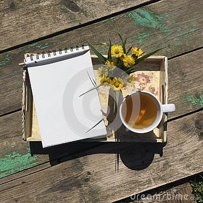 Free Opened Notepad, Cup Of Tea And  Small Bouquet  Of Wild Flowers On A Tray On A Old Wooden  Background. Royalty Free Stock Photography - 102795267
