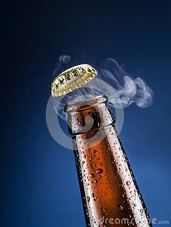 Free Opening Of Beer Cap With The Gas Output. Stock Image - 66555471