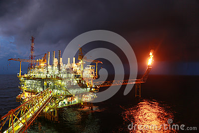 Operator Recording Operation Of Oil And Gas Process At Oil And Rig