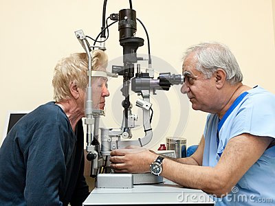 Ophthalmologist examines elderly Editorial Stock Photo
