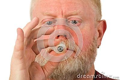 Ophthalmologist holding glass eye