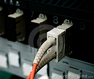 Optic fiber cables connected to a switch