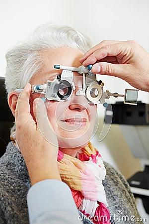 Optician adjusting trial frame for