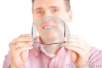 Optician presenting glasses