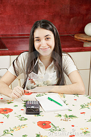 Optimistic housewife with calculator