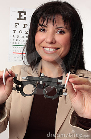 Optometrist holding trial frames