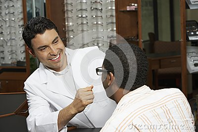 Optometrist Looking At Patient