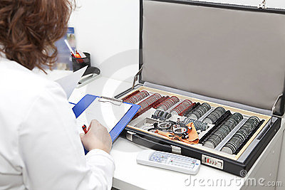 Optometrist preparing diagnosis
