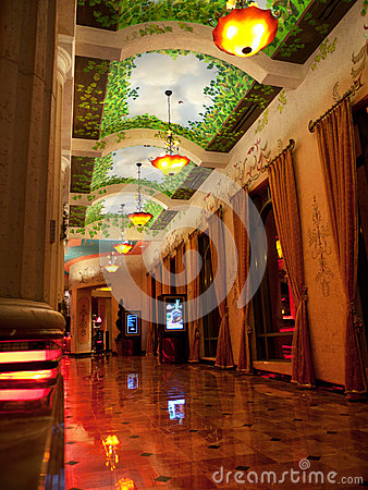 Opulent corridor with marble floor and curtains