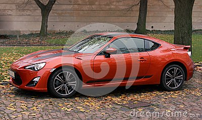 Orange agressive sport car outdoors