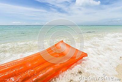Orange Air Mattress In The Sea Stock Image