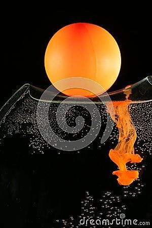 Orange ball and dissolving ink