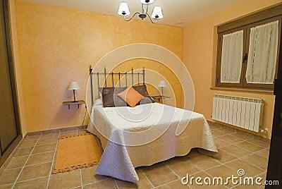 An orange bedroom.