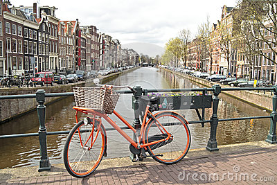 Orange bike in Amsterdam city in the Netherlands